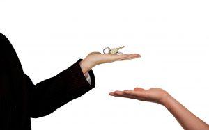 Real Estate Agent Sale Home Keys Hand Handing